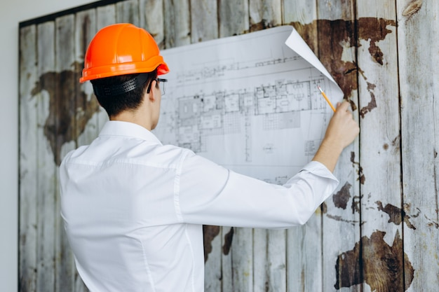 Young man with his back looking at the plan