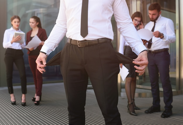 A young man with his pockets turned out against the office