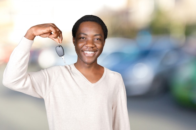Young man with the keys standing