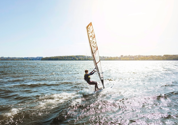 Young man with kitesurf board