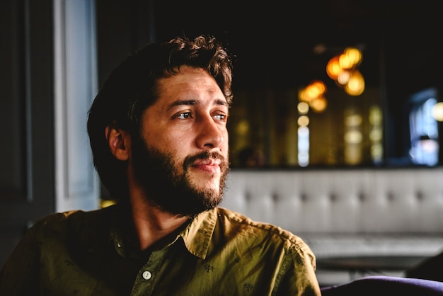 Young man with latin beard looking to infinity thinking about future business.