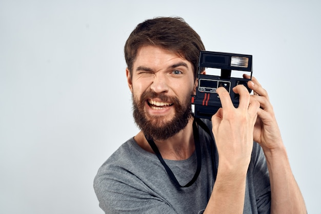 Young man with an old camera