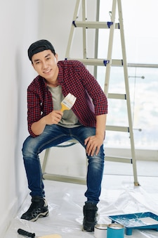 Young man with paint brush