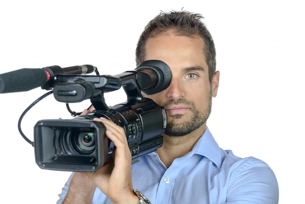A young man with professional movie camera
