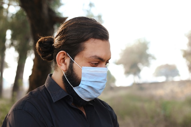 Young man with a protective mask