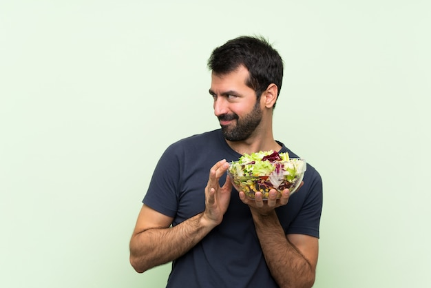 Young man with salad