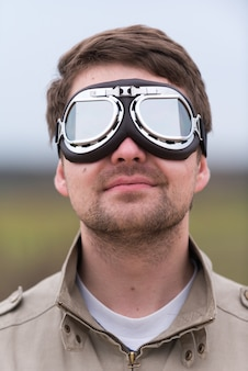 Young man with steampunk aviator goggles