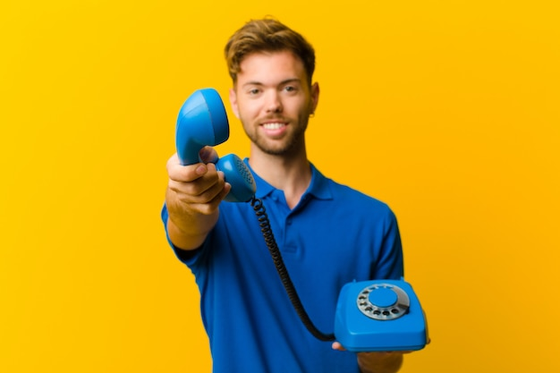 Young man with a telephone