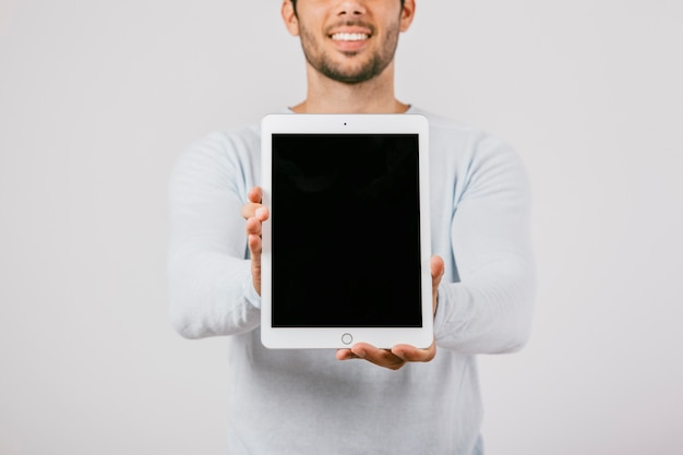 Young man with vertical tablet