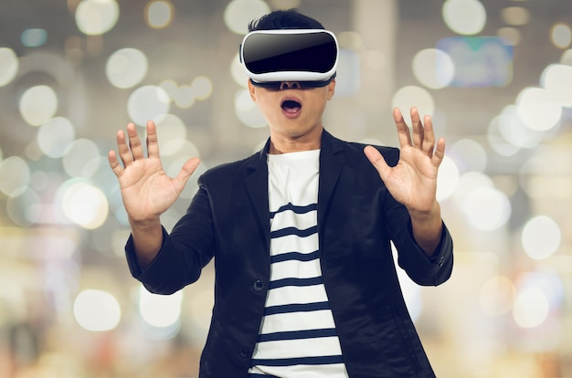 Young man with virtual reality goggles.