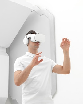 Young man with virtual reality simulator