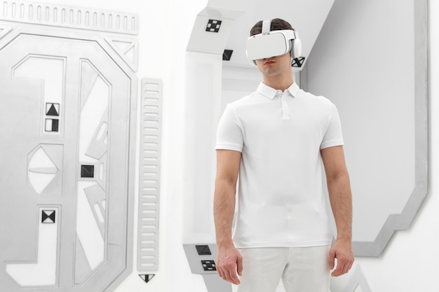 Young man with virtual reality simulator