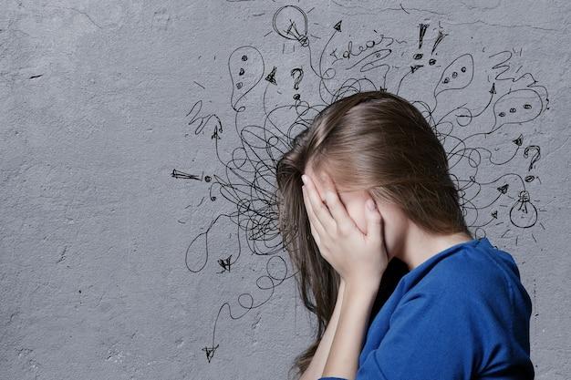 イラストでストレスの多い顔の表情を心配している青年