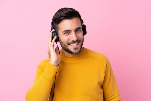 Young man with yellow sweater and headphone