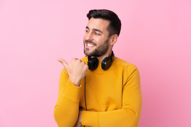 Young man with yellow sweater making a gesture
