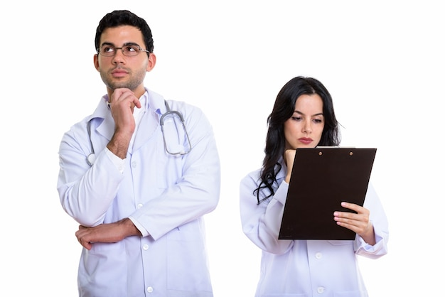 Young man and woman doctor thinking with woman doctor