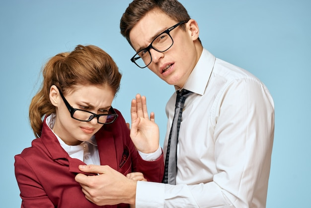 Young man and woman office workers communicate