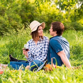 Young man and woman on picnic date
