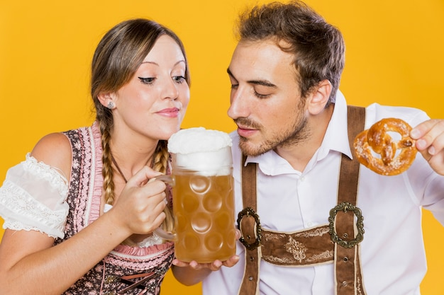 Young man and woman ready to taste beer