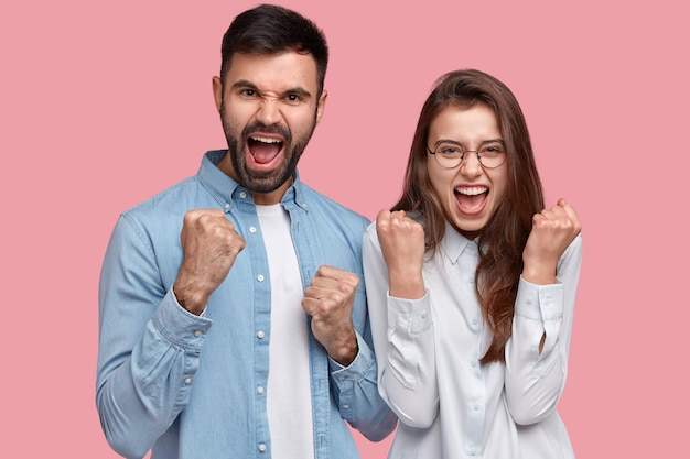 Young man and woman in shirts posing