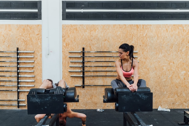 Young man and woman training together