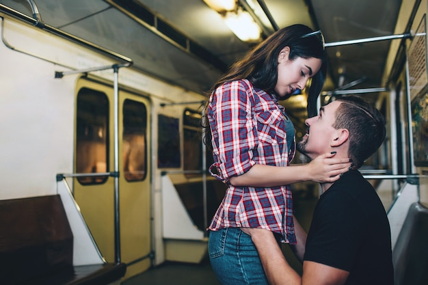 Young man and woman use underground. couple in subway.