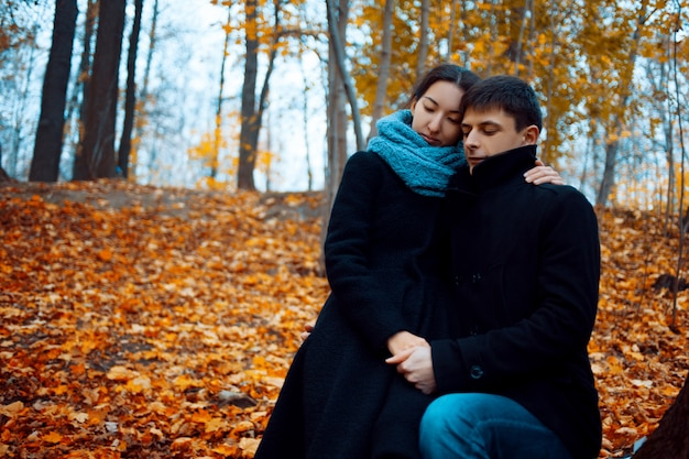 Young man and woman in warm autumn clothes, cashmere coat