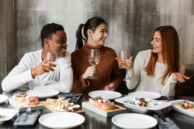 Young man and women having dinner together