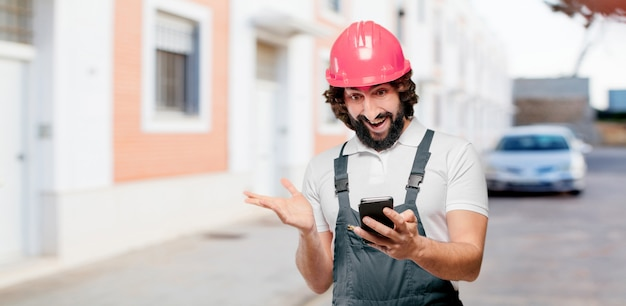 Young man worker with a mobile phone