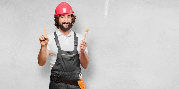 Young man worker with a paint brush