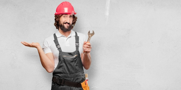 Young man worker with a wrench