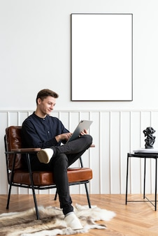 Young man working from home in a cozy reading room