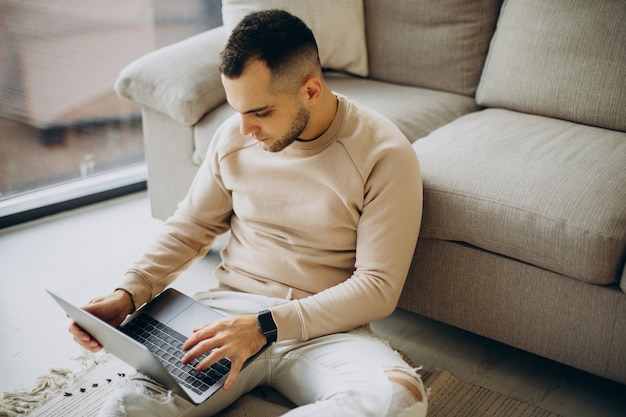 Young man working from home on laptop Free Photo