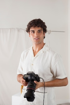Young man working in his photography studio