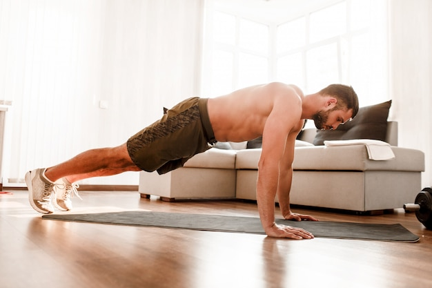 Young man working out at home
