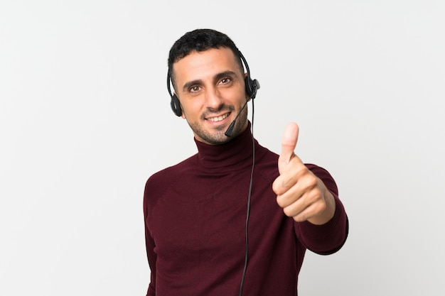 Young man working with headset with thumb up