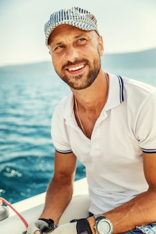 A young man on a yacht in the sea