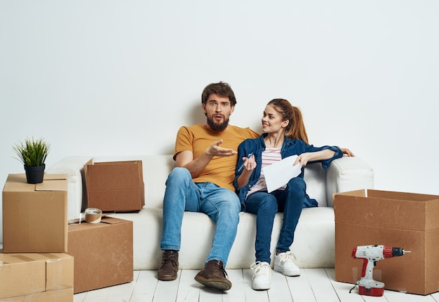 Young married couple room interior cardboard boxes moving