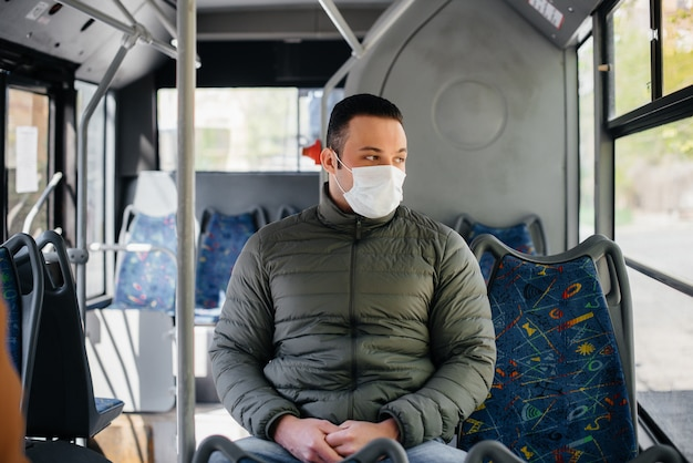 A young masked man uses public transport alone during a pandemic. protectionnd prevention covid 19.
