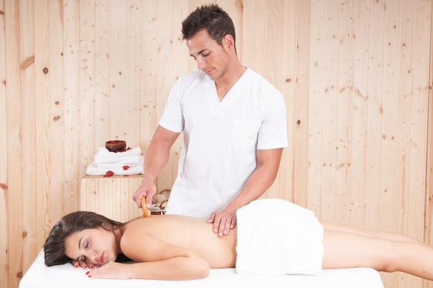 Young masseuse applying a treatment to a girl