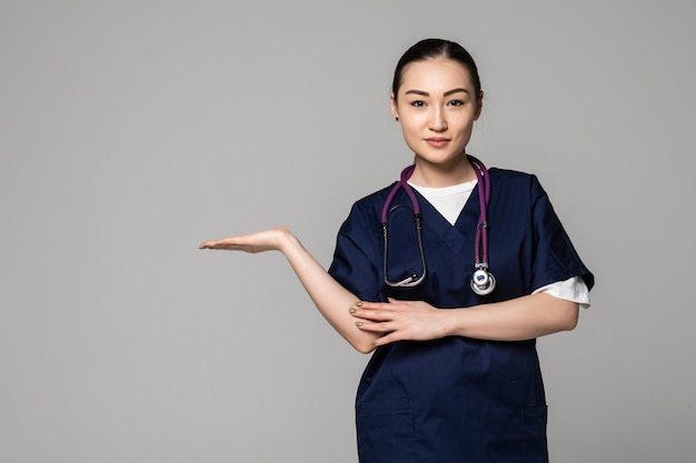 Young medical doctor woman presenting and showing product