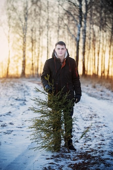 Young men with christmas tree