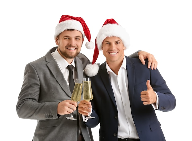 Young men with glasses of champagne on white.