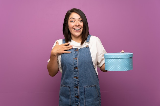 Young mexican woman   holding gift box