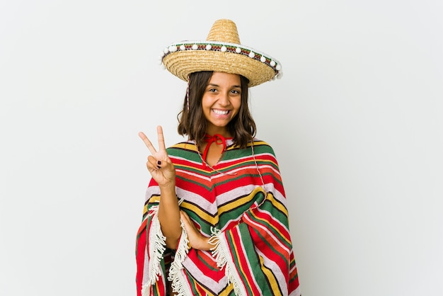 Young mexican woman isolated on white wall showing number two with fingers