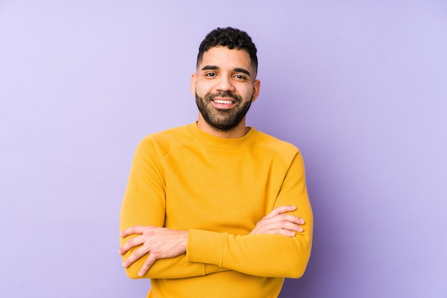 Young mixed race arabic man isolated who feels confident, crossing arms with determination.