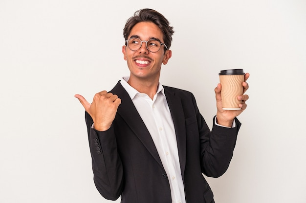 Young mixed race business man holding take away coffee  isolated on white background points with thumb finger away, laughing and carefree.