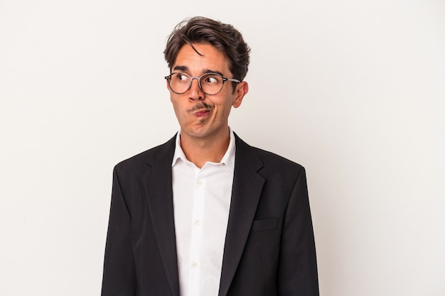 Young mixed race business man isolated on white background confused, feels doubtful and unsure.