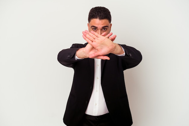 Young mixed race business man isolated on white doing a denial gesture
