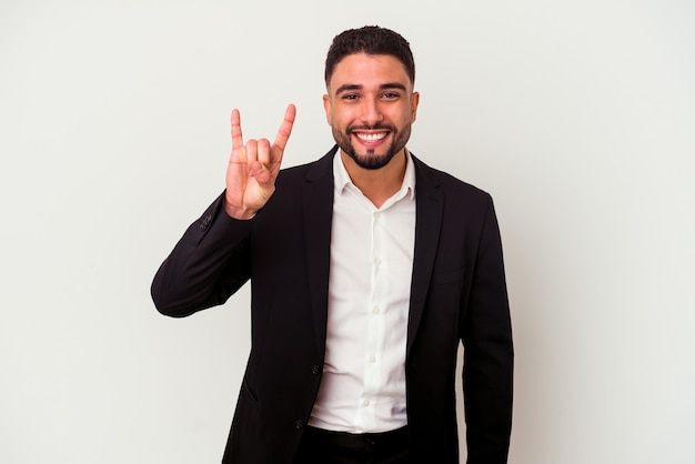 Young mixed race business man isolated on white showing a horns gesture as a revolution concept.